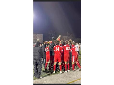 Marist players celebrate with Pulaski Cup after soundly defeating Brother Rice 5-0 March 16, 2021
