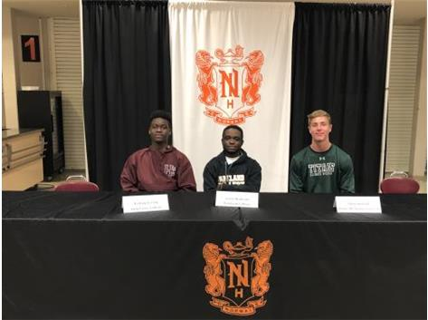 Kamoy Creary (Holly Cross College), Josue Nsukami (Illinois Wesleyan University) & Ethan Holland (Parkland College) signing to play soccer at the collegiate level.