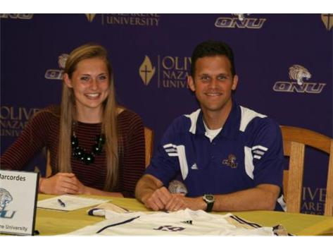 Tess Marcordes signed her National Letter of Intent to continue her soccer career at Olivet Nazarene University. Also pictured: Coach Bill Bahr.