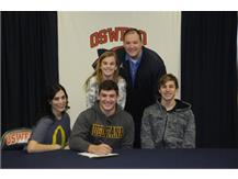 Dayne Millard signs to continue playing Football at Augustana College.