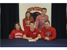 Nathan Ricken signs to continue playing Football at Carthage College.