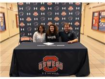 Cheyenne Woerman signs with Macalester College to continue playing Softball.
