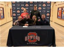 Jack Hugunin signs with Northern Illinois University to continue playing Football.
