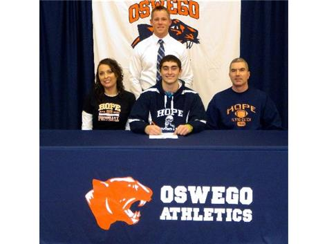 Tyler Gibson signs with Hope College to play Football.
