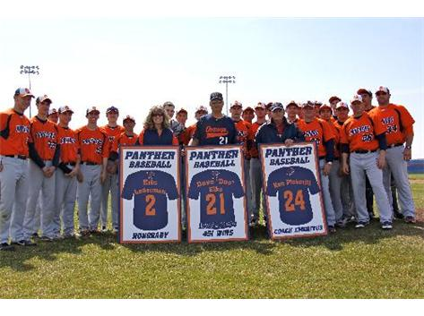 The Panther Baseball Team surrounds Cheryle Lederman, Doc Elko and Coach Pickerill on their special day!