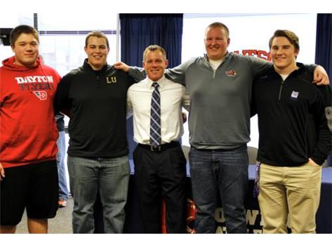 Coach Cooney with his Football Linemen on signing day.