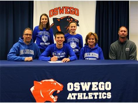 Tyler Guist signs with St Louis University to Swim.