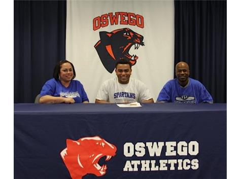 Freddy Walton signs with University of Dubuque to play Football.