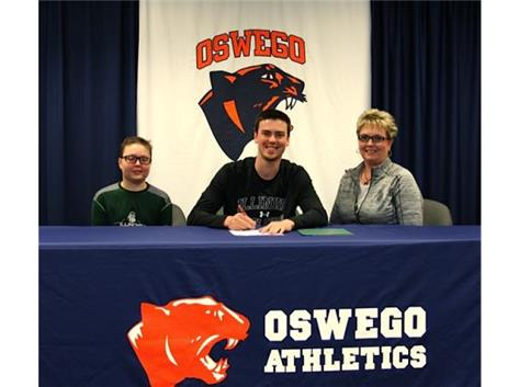 Brice Robinson signs with Illinois Wesleyan University to play Boys Basketball.