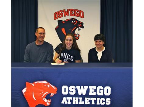 Holly Behrends signs with University of North Carolina Greensboro to play volleyball.