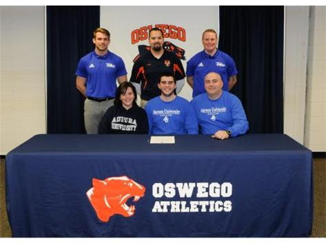 Nick Kearns signs to continue playing Soccer at Aurora University.