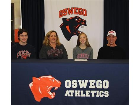 Alyssa Radakovich signs with Grinnell College to continue playing Soccer.