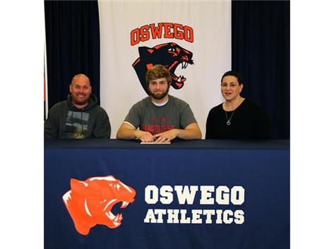 Matt Dutton signs with Benedictine University to continue playing Football.