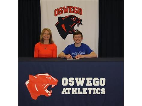 Luke Pradel signs with University of Wisconsin-Platteville to continue Wrestling.