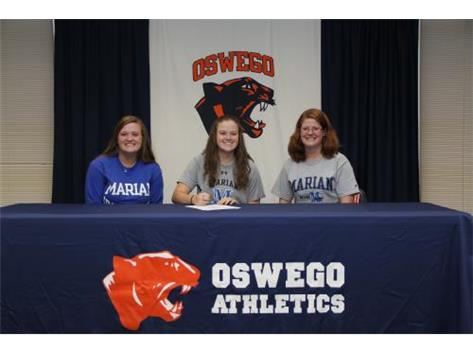 Rachel Mereness signs with Marian University to continue playing softball.