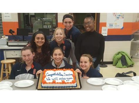 Seniors with the Senior night cake