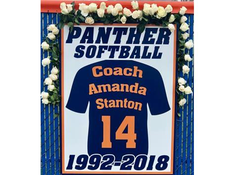 Retired softball # 14 sign hanging on left field fence at varsity softball field.  Dedicated 4-7-2019.