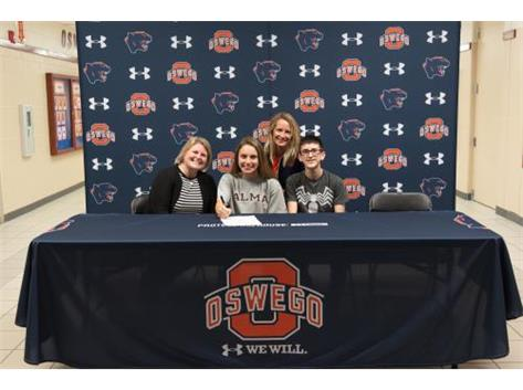 Natalie DelaColina signs with Alma College to continue playing Volleyball