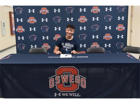 Jesse Moreno signs with St. Ambrose University to continue playing Volleyball