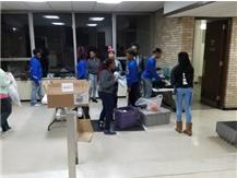 Lady Pirates sorting clothes at St. John's Homeless Shelter in Forest Park on 12.23.16