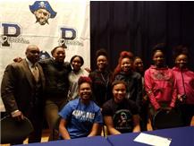 Dee & Kyla signing day with teammates and Bellwood Mayor Harvey.