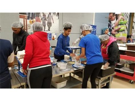 Lady Pirates at work packing food.