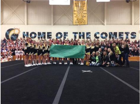 The RCHS CHeerleaders raised almost $1,000 for a fallen Bishop MacNamara cheerleader, Kaelynn Fae, at their Comet Cheerleading Invitational.  They presented the money to the Bishop Mac cheer team and Kaelynn's Mom and Sister.  The money will be put toward the Kae Fay Memorial Scholarship.