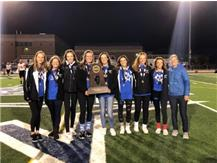 Girls Golf shows off their State Championship hardware.