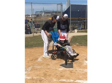 Baseball helping out with the Bartlett Little League Challengers, a baseball program devoted to helping athletes with special needs.