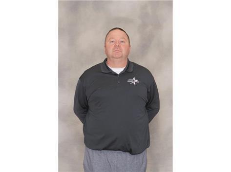 Head Coach Tom Poulin