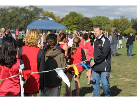 Mr. Haber assisting at the finish