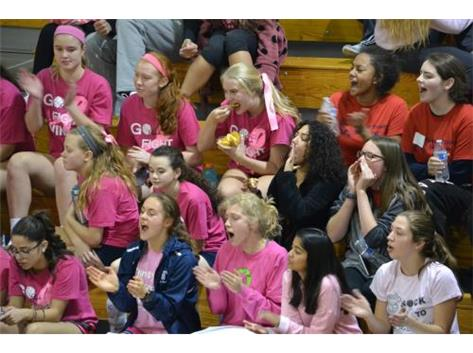 Pep club cheering on Volleyball for the PINK OUT!