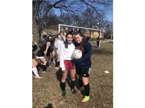 Soccer team enjoys a fun practice before parent meeting
