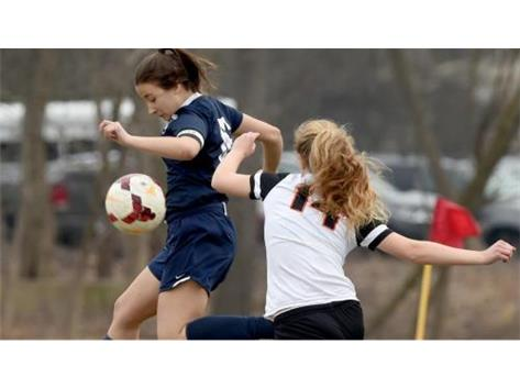 Trinity's Samantha Salcedo (left) controls the ball during a game against Lake Forest Academy. (Rob Dicker / Chicago Tribune)