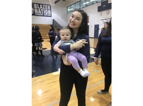 Senior, ALyssa Bennett, with Coach Steil's daughter, Eloise.