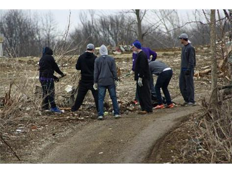 The 2014 varsity baseball team spent several hours on March 28th helping with the clean up for the Washington Illinois tornado victims.