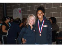 Coach Clousing and Keisha at the State Recognition Ceremony