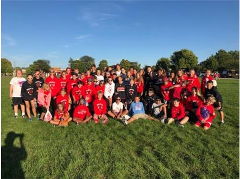 The boys and girls teams pose before walking in the YHS homecoming parade in 2019.