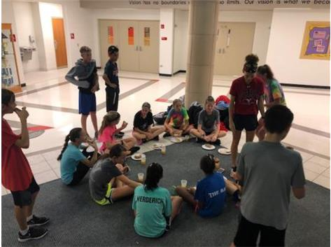 The cross country sectional runners stretch together after practice in 2019.