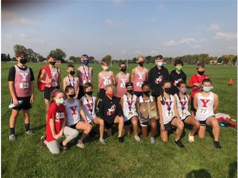 The boys and girls teams pose together at the sectional meet in fall 2020.