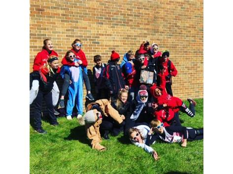 The boys and girls cross country teams pose after running at IESA Sectional meet at Troy Middle School in Plainfield, IL.