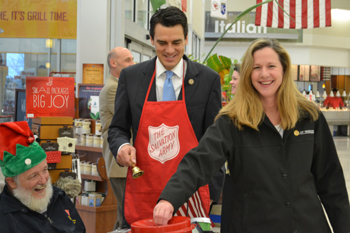 David Perryman gots some help from U.S. Rep. Kevin Yoder and Mission Mayor Laura McConwell Friday.