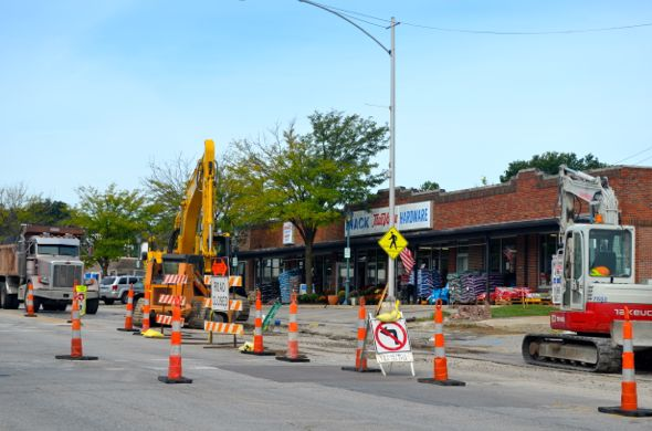 Utility crews were at work as usual on Johnson Drive Friday morning. Drivers sometimes find it difficult to negotiate the cones into business parking.
