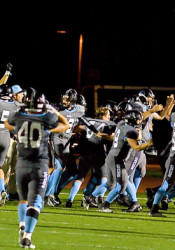 """SM East's football squad and its fans lived their """"go bananas"""" chant after their wild last-second victory Friday."""