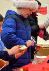 Cookie decorating was a popular table in the warmth of the Sylvester Powell Community Center.
