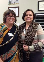 Indian Hills teacher Judith Schieszer (left) and KU economics professor Nadia Kardash.