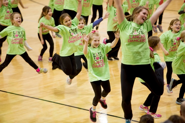 Little Lancer Dancers put on the halftime performance at the SM East girls basketball game Monday.