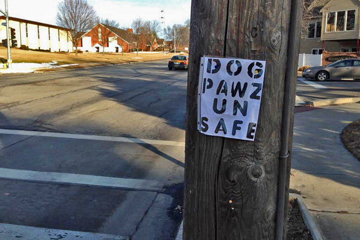One of the signs claiming Dog Pawz is unsafe, posted at 79th Street and Mission Road.