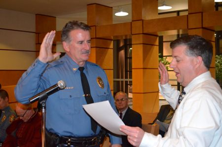 Westwood City Clerk Fred Sherman delivered the oath of office to new police chief Greg O'Halloran Thursday evening.