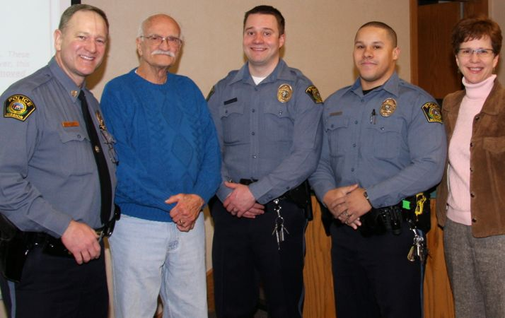 Acting Police Chief David Moloy, Clay Phillips, officers